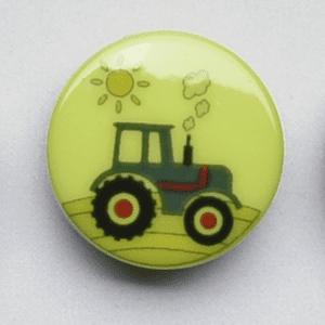 Knap med grøn traktor