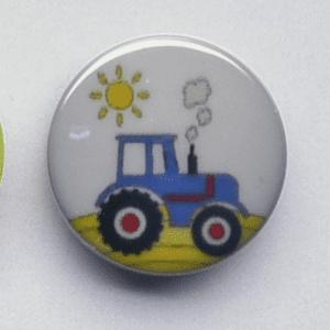 Plastikknap med traktor